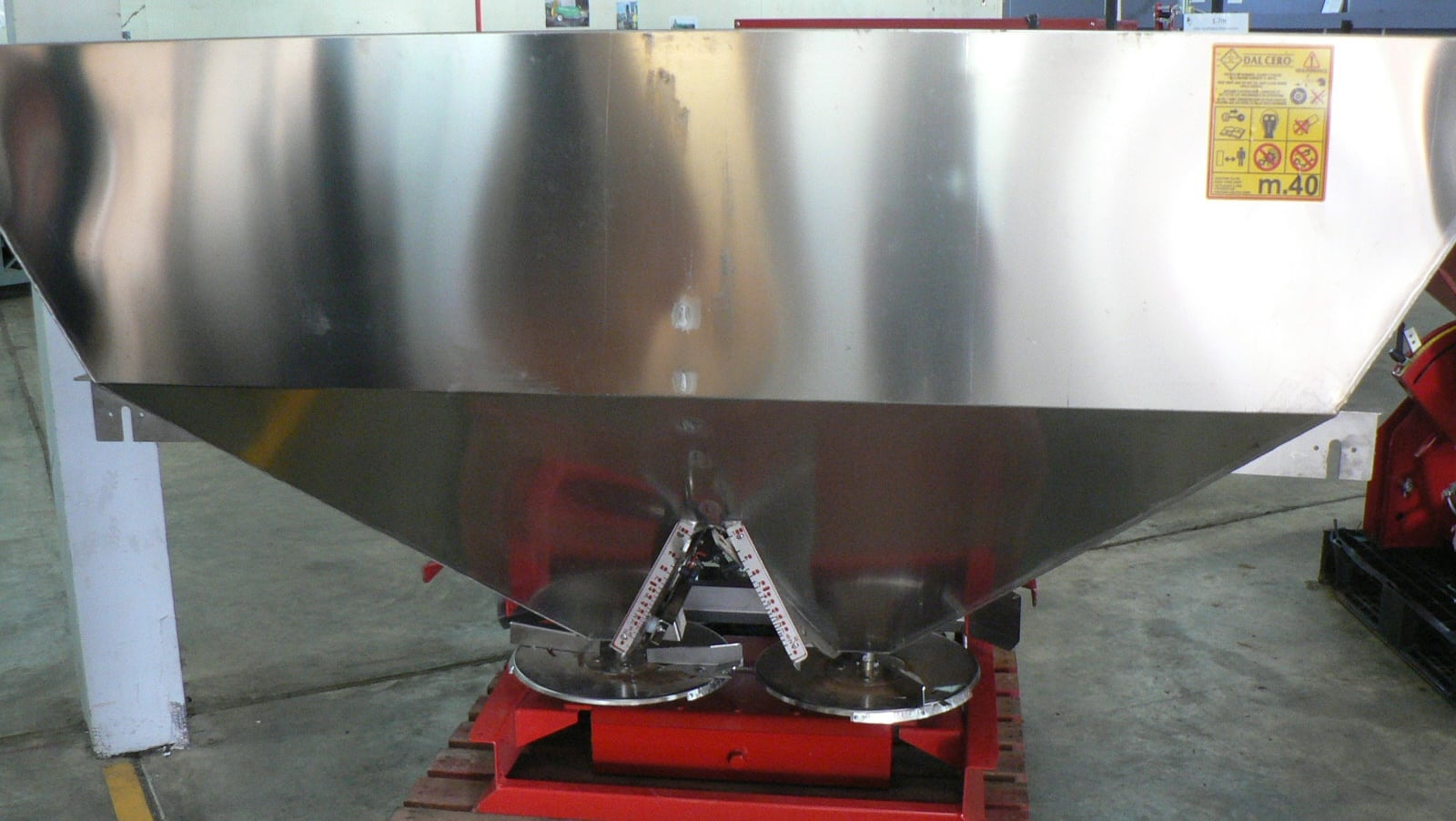 A double spinning disc spreader with 2000L capacity stainless steel hopper. 10-24m spread width.