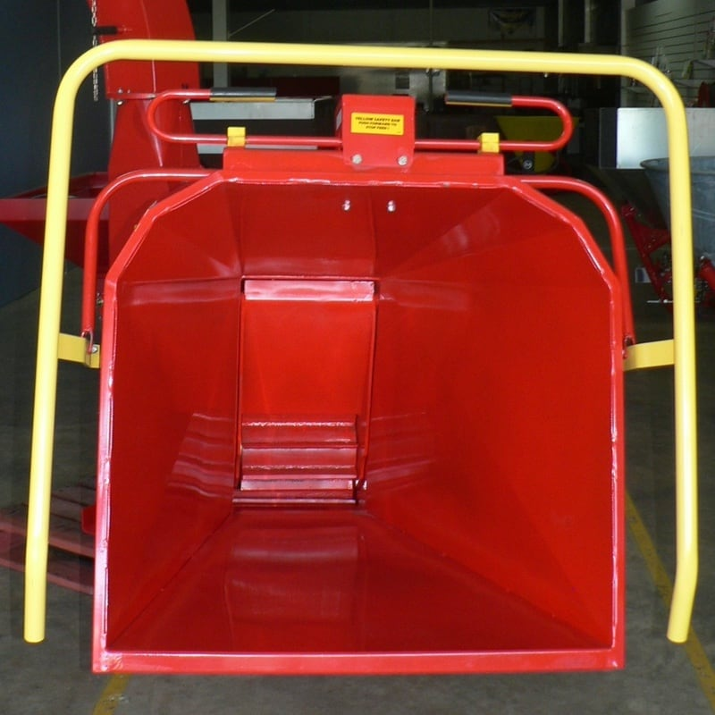 The hydraulic infeed chute showing the safety bar and feed direction lever.